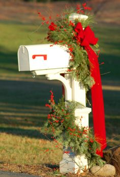 Mailbox decorated with largely natural materials for Christmas. See more Christmas scenes at http://landscaping.about.com/od/galleryoflandscapephotos/ig/Christmas-Scene-Pictures/