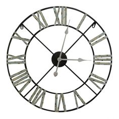 Massive scale and rustic, antiqued metal construction combine give this oversized wall clock a dramatic look. Featuring subtle green shaded Roman numerals in a simple, bold design, this versatile piece works well in a variety of homes.