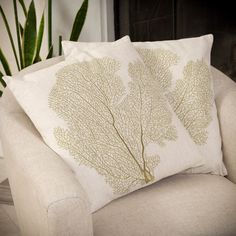 Add these unique square embroidered pillows to your home's style. The beige color and linen blend cover are great additions to the beauty of your couch. These pillows also come in pairs and can easily be spot cleaned with a damp cloth.