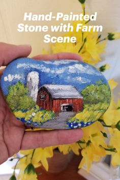 """Collectible, one-of-a-kind original artwork on smooth river stone. Keep for yourself or give as a special gift! Comes in a pretty blue drawstring pouch. Painted in acrylics and sealed with clear satin varnish, this piece may be used indoors as decor, a paperweight in the office, or outside as garden decor. 4 """"wide and 2.5""""tall Hand Painted Rocks, Painted Stones, Barn Art, Stone Barns, Farm Barn, Drawstring Pouch, Small Art, Handmade Decorations, Stone Painting"""