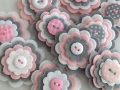 ***BABY GIRL GREY*** Set of 3 Handmade felt & button embellishments   Embellishments in this listing are made with quality felt in Baby Pink, Silver Grey & White and centered with the hand stitched button.  Each pack contains x3 gorgeous felt flowers chosen at random by me.   These are perfect for brooches, clippies, embellishments, hair pieces, bunting, card making, scrapbooking uses are really endless...  ***Please note: The flowers you receive may be not exactly as pictured, but they will…