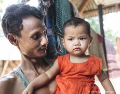 Khasi tribal man with his daughter, Khasi tribe,  Nirala Para (village), Sreemangal (Srimangal), Division of Sylhet, Bangladesh, Indian Sub-Continent, Asia
