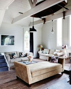 Living room details. 'The living room is the best place to appreciate the volume, light and acoustics of the church,' says Elise. Framed pho...