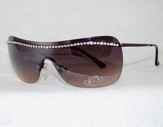 "Enchanting Jewelry Creations - ""Bling Rimless Uni-lens Rhinestone rhinestone Sunglasses.   ($15.00) (http://stores.enchantingjewelrycreations.com/bling-rimless-rhinestone-bridge-Uni-Lens-sunglasses/)"