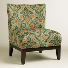 Our Woodlands Darby Chair features our exclusive floral pattern in sage green and orange. With a luxuriously deep seat, this stylish slipper chair makes a chic addition to your living decor.