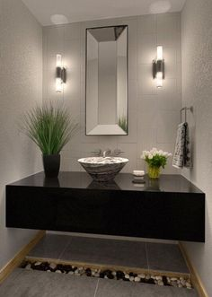 "Contemporary Powder Room with Montauk black / 12""x24"", Simple granite counters, Powder room, Wall sconce, Vessel sink"