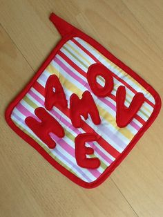A 'It;s Tasty' potholder also came along in the striped series, in Latin, at Vardenis Sewing.