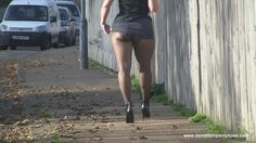 Public pantyhose video of sexy big bottom UK woman in ass revealing mini skirt, black pantyhose tights and heels in the street. Her nylon butt cheeks are on show.