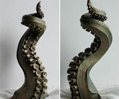 Tentacle Candle Holder  From the depths of the murky sea arises this massive tentacle candle holder. Created with influences from classic tales of sea monsters, the Tentacle Candle Holder is a very unique way to display your candles in your home.