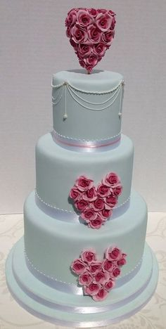 Wedding cake with sugar flower hearts and royal icing detail