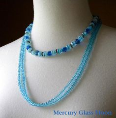 three ice blue glass necklaces
