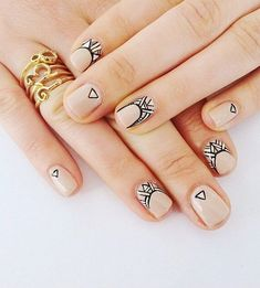 Simple and pretty looking abstract nail art design. Using nude, white and black polish, you can make your nails your very own canvas and create works of art.