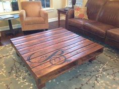How to Make the Perfect Pallet Coffee Table monogrammed pallet table. I like this for outdoor space maybe even a bit more rustic. beautiful coffee table The post How to Make the Perfect Pallet Coffee Table appeared first on DIY Crafts. Pallet Crafts, Pallet Projects, Home Projects, Wood Crafts, Diy Crafts, Wood Pallets, Pallet Wood, Diy Pallet, Pallet Couch