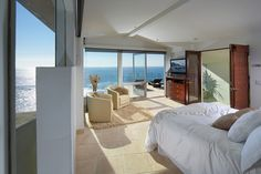 """""""It feels like you are on the ocean,"""" Mr. Boyd says of the master bedroom, pictured. The houses boasts 180-degree views of the ocean as well as north and south Laguna Beach."""