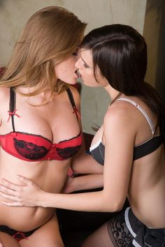 two non nude girls kissing