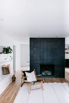 Most up-to-date Photographs Brick Fireplace design Ideas Fantastic Pic thin Brick Fireplace Concepts Modern Black Brick Fireplace Surround Black Fireplace Surround, Black Brick Fireplace, Brick Fireplace Makeover, Small Fireplace, Concrete Fireplace, Fireplace Hearth, Home Fireplace, Living Room With Fireplace, Fireplace Surrounds