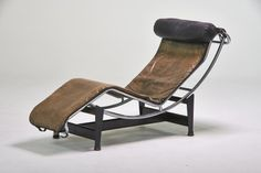 """Lot No. 604 Le Corbusier/Cassina """"LC4″ adjustable chaise lounge, Italy, 1970s; Chromed and enameled steel, leather; Stamped maker's mark"""