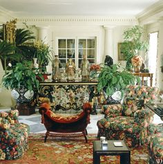 Look Inside Valentino's Extravagant Roman Home Photos   Architectural Digest [Lush floral prints abound in the living room, complemented by a French needlepoint carpet and embroidered-velvet bench. Three Chinese dignitaries—polychrome figures made for the Royal Pavilion at Brighton—stand atop an Italian lacquer-and-gilt table.]