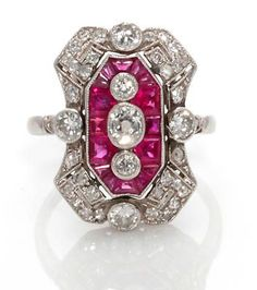 An art deco ruby and diamond ring, French, circa 1925 featuring calibré-cut rubies accenting oval, old European, single and rose-cut diamonds; reference no. 16497; with French assay mark; mounted in platinum.