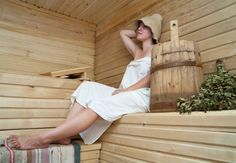 Buy Young woman take a steam bath at sauna by JackF on PhotoDune. girl in white sheet sits on a bench in a sauna Benefits Of Steam Bath, Sauna Benefits, Traditional Saunas, Steam Sauna, Moist Heat, Wooden Room, Infrared Sauna, Steam Room, Massage