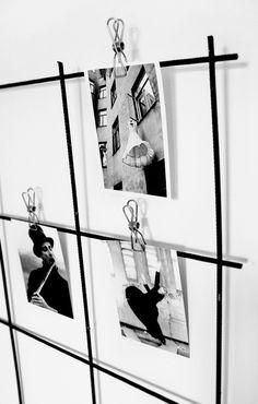 Zdjęcia powieszone na klamrach