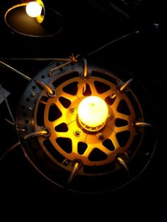 use as inspiration for a recycled hubcap wall lamp