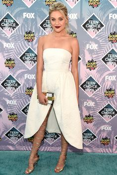 KELSEA BALLERINI at the Teen Choice Awards 2016 in a white strapless Cynthia Rowley dress and silver DSquared thigh-high lace up sandals