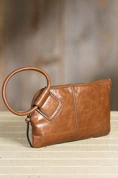 Premium leather that's gently broken in and tumbled for a soft sheen charges this mighty wristlet wallet with character.
