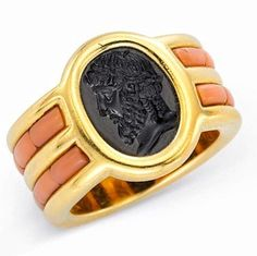 Jewels by JAR #jarparis #jar #joelarthurrosenthal #jewelsbyjar #jarjewelry #jarjewels #JARjewellery #LucDanto via FD Gallery -A Gold, Coral, and Obsidian Ring Designed as a wide polished gold band, set to the center with an oval-shape obsidian plaque, carved intaglio with a male figure, to the half hoop enhanced by calibré-cut angel skin coral, mounted in 18K yellow gold.