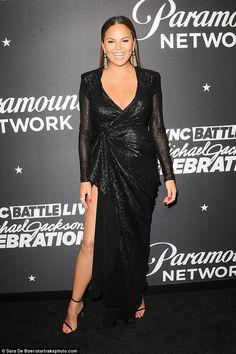 Chrissy Teigen goes braless in low-cut black dress   Daily Mail Online