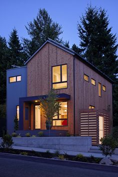 Exterior of the Everett model home at dusk.  Photography by Anthony Rich.