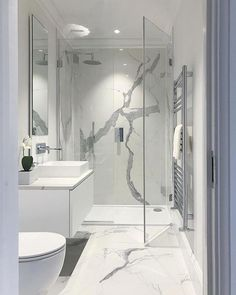 En suite bathroom with large format polished statuario marble porcelain. En suite bathroom with large format polished statuario marble porcelain. Bathroom Design Luxury, Bathroom Layout, Modern Bathroom Design, Luxury Bathrooms, Master Bathrooms, Marble Tile Bathroom, White Marble Bathrooms, Marble Tiles, Gold Bathroom