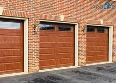 Shown here are long panel, highly insulated steel garage doors by Clopay. The color is 'Ultra-Grain Medium' factory finish and the garage door windows have 'Prairie' inserts and are insulated too! The homeowners love the doors because they have the look of wood with the ease of steel. | ProLift Garage Doors on Houzz | Project and Photo Credits: ProLift Garage Doors Va | #garagedoors #insulatedgaragedoors