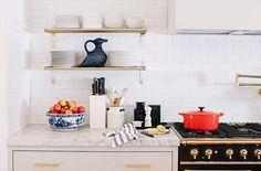 simple brass kitchen shelves; open shelving