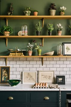 dark green kitchen This DeVol kitchen is gorgeous - I love the earthy green paint, rustic wooden shelves and dark grey cabinets, which are brought together by the light marble workto Kitchen Shelves, Kitchen Tiles, New Kitchen, Vintage Kitchen, Kitchen Decor, Green Kitchen Cupboards, Natural Kitchen, Kitchen Small, Art For The Kitchen