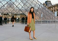 Giovanna Engelbert in a Prada skirt and shoes