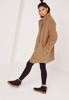 Warm up and score some new in this seriously on point faux wool coat. Trending for the new season are shearling coats and we can't get enough. Featuring a light country tan hue, a grungy teddy style, satin lining, button up front, two pock...