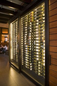 Amazing wine cooler the moment you walk in the door. Perfect separation between lobby and dining area.