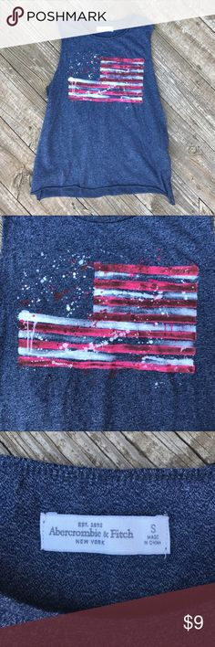 A&F American Flag Muscle Tee This is an incredibly soft muscle tee from Abercrombie and Fitch with a unique American Flag🇺🇸 on the front. It has little slits on the sides at the bottom of the shirt for added detail. It would be great for a workout or just a simple outfit. Very cute and in excellent condition EUC!  Feel free to ask any questions or make an offer. Notice: I reuse packaging to reduce waste💖🌷🌎! Abercrombie & Fitch Tops Muscle Tees