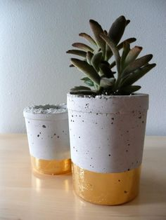 A collection of cement planters wrapped in metal leaf from Austin, TX-based designer Joanna Wojtkowiak http://felizsale.com/meet-the-makers-oh-laszlo/