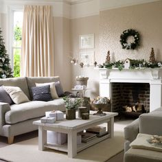 Wintry Christmas living room decorating idea from Ideal Home on Roomenvy (Logs in middle of table)