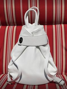 Summer is over but you can still wear white through the winter! This thick Italian Leather Backpack Purse is stylish and functional. Zip closure with inside zip and 2 slip wall pockets perfect for the cell phone and glasses. Checkout all the ways to carry on our website. Available in several colors. #womensbackpack #womensleatherpurse #womensleatherpursesandwallets #orangehandbags #whitehandbags #leathertote #fashion #purse #giftforher