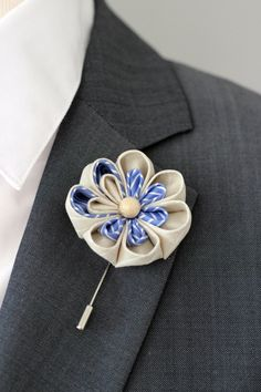 A personal favourite from my Etsy shop https://www.etsy.com/listing/237125938/ivory-and-blue-lapel-flower-pin-blue