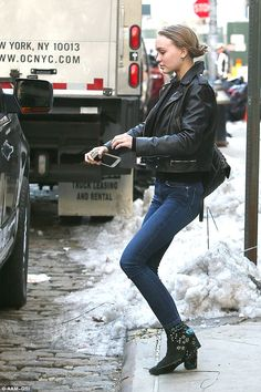 Beauty:She added a pair of black booties to her biker chic look as she showed off her petite frame in the stylish attire