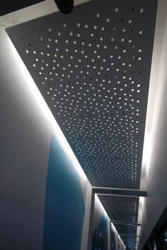 Key Plasterboard 13mm plasterboard with a custom design, this was a project for a local carwash in Canberra Australia . The custom design looks random yet if you look closely it creates a specific aspect for both aesthetics and acoustic performance. The custom perforated design also gives a great lighting effect.
