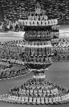 Soviet dancers and gymnasts rehearse for the opening ceremony of the twenty-second Olympic Summer Games, at Moscow's Lenin Stadium. The Games officially opened on July 19, 1980. Photograph by AP. °