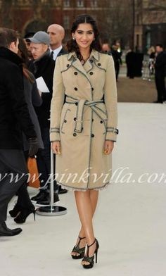 Sonam Kapoor at the Burberry Prorsum AW 2012 show during London Fashion Week wearing a Burberry coat.
