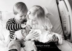 siblings and baby at hospital