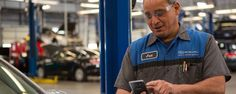 A mechanic at Continental Automotive Group illustrates the benefits of using smartphones in retail with the Samsung Galaxy S7.