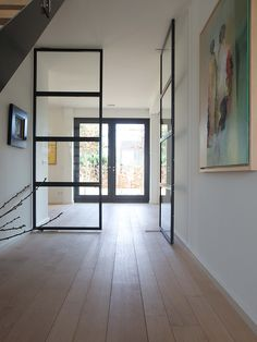 french oak flooring in a hallway with glass doors